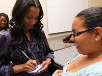Dr. Michelle signing autograph